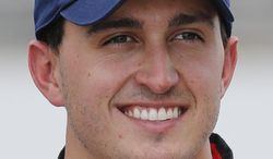 """In this May 17, 2014 photo, Graham Rahal poses for a photo after his qualification run on the first day of qualifications for Indianapolis 500 IndyCar auto race at Indianapolis Motor Speedway in Indianapolis. No single driver or team has risen to the top this season. And with so much attention on Kurt Busch, who will become just the fourth driver in history to compete in both the 500 and NASCAR's Coca-Cola 600 on the same day, so many other elements of this magical race at historic Indianapolis Motor Speedway have been somewhat overlooked. """"I don't know that there's a favorite at all this year,"""" said Rahal. """"I feel like it is extremely wide open at this point, even as a driver myself, I couldn't even tell you who I would pick. I have no clue."""" (AP Photo/Dave Parker)"""