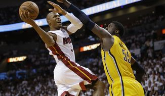 Miami Heat guard Ray Allen (34) drives to the basket over Indiana Pacers center Roy Hibbert (55) during the second half of Game 3 in the NBA basketball Eastern Conference finals playoff series, Saturday, May 24, 2014, in Miami. (AP Photo/Lynne Sladky)