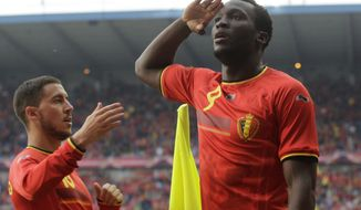 Belgium's Romelu Lukaku, right, salutes next to team mate Eden Hazard, after he scored against Luxembourg, during a friendly soccer match at the Cristal Arena stadium in Genk, eastern Belgium, Tuesday, May 26, 2014. Belgium will play against South Korea, Russia and Algeria in Group H of the World Cup 2014 in Brazil. (AP Photo/Yves Logghe)