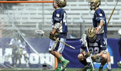 Notre Dame players, left to right, Garrett Epple, Jack Near and Stephen O'Hara walk off the field after losing to Duke 11-9 in the NCAA championship lacrosse game Monday, May 26, 2014, in Baltimore.(AP Photo/Gail Burton)