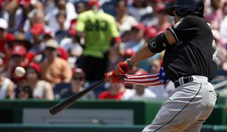 Miami Marlins' Giancarlo Stanton hits a two-run homer during the third inning of a baseball game against the Washington Nationals at Nationals Park Monday, May 26, 2014, in Washington. (AP Photo/Alex Brandon)