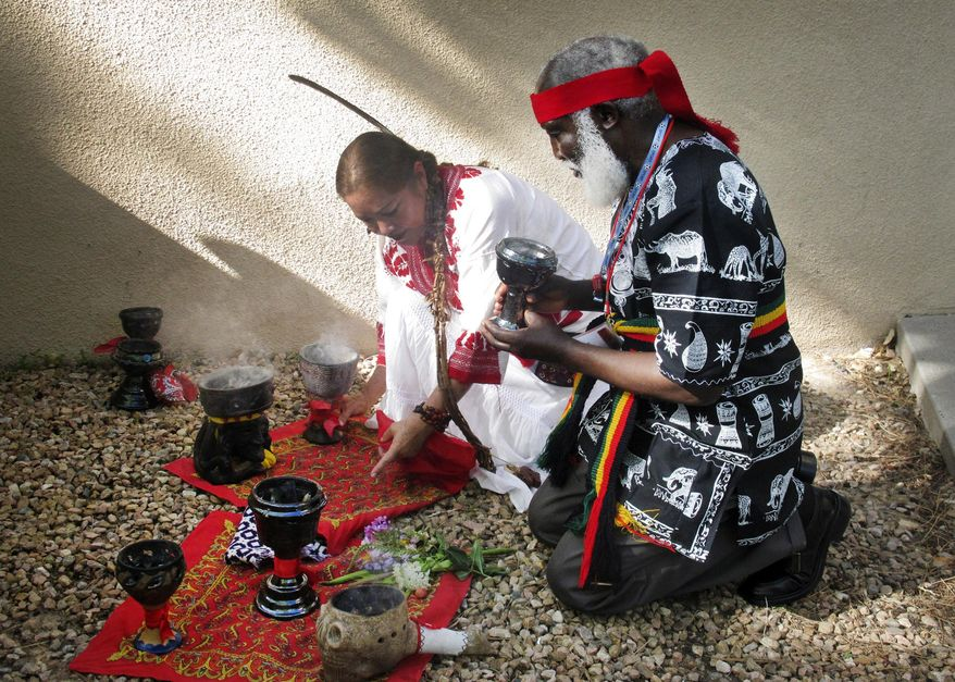FILE - This July 22, 2013 file photo shows curanderos, or traditional healers, conducting a ceremony on the campus of the University of New Mexico in Albuquerque. The University of New Mexico is going to offer a free online class on curanderismo, the art of traditional healing. The school announced in May 2014 it will host the Massive Open Online Course as an offshoot of its popular curanderismo class offered on campus every summer.(AP Photo/Russell Contreras, file)