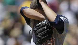 Detroit Tigers' Drew Smyly wipes his face in the fourth inning of a baseball game against the Oakland Athletics Monday, May 26, 2014, in Oakland, Calif. (AP Photo/Ben Margot)