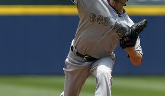 Boston Red Sox's Clay Buchholz (11) pitches against the Atlanta Braves during the first inning of a baseball game on Monday, May 26, 2014, in Atlanta, Ga. (AP Photo/Butch Dill)