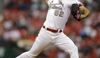 St. Louis Cardinals starting pitcher Michael Wacha throws during the first inning of a baseball game against the New York Yankees Monday, May 26, 2014, in St. Louis. (AP Photo/Jeff Roberson)