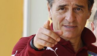 Italy coach Cesare Prandelli points his finger during a team training session at Coverciano training grounds, in Florence, Monday, May 26, 2014. In Brazil, Italy is in Group D with England, Uruguay and Costa Rica. (AP Photo/Fabrizio Giovannozzi)