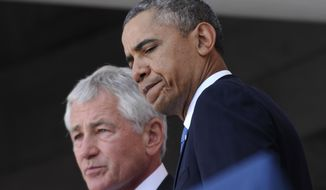 President Barack Obama and Defense Secretary Chuck Hagel participate in a Memorial Day ceremony at Arlington National Cemetery in Arlington, Va., Monday, May 26, 2014. Obama, who returned just hours earlier from a surprise visit with U.S. troops at Bagram Air Field in Afghanistan, paid tribute to those lost in battle there and elsewhere over history as he commemorated Memorial Day.  (AP Photo/Susan Walsh)