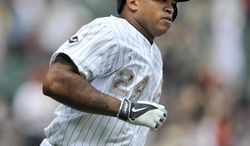 Chicago White Sox's Dayan Viciedo watches his three run home run during the third inning of a baseball game against the Cleveland Indians in Chicago, Monday, May 26, 2014. (AP Photo/Paul Beaty)