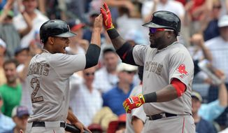 Boston Red Sox David Ortiz, right, celebrates his three run homer with teammate Xander Bogaerts in the fifth inning of a baseball game against the Atlanta Braves in Atlanta, Monday May 26, 2014. (AP Photo/Atlanta Journal-Constitution, Brant Sanderlin )  MARIETTA DAILY OUT; GWINNETT DAILY POST OUT; LOCAL TV OUT; WXIA-TV OUT; WGCL-TV OUT   .