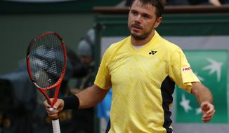 Switzerland's Stanislas Wawrinka reacts as he plays Spain's Guillermo Garcia-Lopez during their first round match of  the French Open tennis tournament at the Roland Garros stadium, in Paris, France, Monday, May 26, 2014. (AP Photo/Michel Euler)