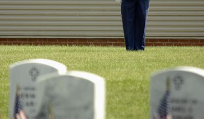 "Staff Sgt. Glen Johnson, Indiana Army National Guard Honor Guard, sounds ""Taps"" during the Memorial Day ceremony at Marion National Cemetery in Marion, Ind., on Monday, May 26, 2014. (AP Photo/The Chronicle-Tribune, Jeff Morehead)"