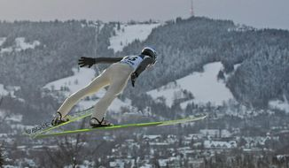 FILE - In this file photo taken Jan. 12, 2013, Austria's Michael Hayboeck is seen soaring through the air during the qualification round of the16th World Cup Ski Jumping competition, in Zakopane, Poland. Zakopane was to be one of the sites of the 2022 Winter Games that the nearby city of Krakow was bidding to co-host, but cancelled the effort the day after the residents voted against the plan in a local referendum on Sunday, May 25, 2014. (AP Photo/Alik Keplicz, file)