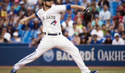 CORRECTS TO HUTCHISON FROM HUTCHINSON - Toronto Blue Jays starting pitcher Drew Hutchison works against the Tampa Bay Rays during the first inning of a baseball game in Toronto on Monday, May 26, 2014. (AP Photo/The Canadian Press, Nathan Denette)