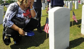 Victoria L. Coman-Jackson visits her husband's Dennis Wayne Jackson's grave after the annual Memorial Day Ceremony at the Alabama National Cemetery in Montevallo, Ala., Monday, May 26, 2014. (AP Photo/AL.com, Joe Songer) MAGS OUT