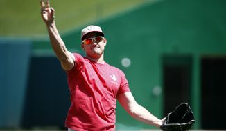 Washington Nationals' Ryan Zimmerman plays catch before a baseball game against the Miami Marlins at Nationals Park Monday, May 26, 2014, in Washington. Zimmerman is on the disabled list with an injured right thumb. (AP Photo/Alex Brandon)