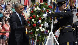 President Barack Obama lays a wreath at the Tomb of the Unknowns at Arlington National Cemetery in Arlington, Va., Monday, May 26, 2014. Mr. Obama is leading the nation in remembering its war heroes, the fallen and those still defending the flag, in a Memorial Day tribute. (AP Photo/Susan Walsh)
