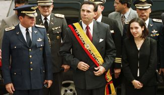 FILE - In this Jan. 15, 2000 file photo, Ecuador's President Jamil Mahuad, center, his daughter Paola Mahuad, right, and military officials arrive to Congress in Quito, Ecuador. Ecuadorean authorities announced on Tuesday, May 27, 2014 via Twitter that an arrest warrant has been issued for former President Jamil Mahuad for allegedly misappropriating public funds during the country's late 1990s banking crisis. Mahuad fled a 2000 coup and settled in the United States. (AP Photo/Silvia Izquierdo, File)