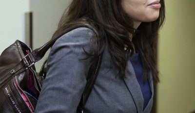 FILE - In this April 1, 2013 file photo, New York-based Fox News reporter Jana Winter arrives at district court in Centennial, Colo., where she was subpoenaed to testify about who gave her confidential information about a notebook James Holmes sent to his psychiatrist days before he allegedly opened fire on a crowded movie theater in July 2012, killing 12 people. The U.S. Supreme Court said Tuesday, May 27, 2014 that Winter does not have to reveal her confidential sources for a story about Holmes.(AP Photo/Ed Andrieski, File)