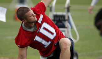 Tennessee Titans quarterback Jake Locker stretches during NFL football minicamp, Tuesday, May 27, 2014, in Nashville, Tenn. Locker is back on the field with the Titan--a couple of weeks ahead of the schedule doctors estimated for his return from an injured right foot. (AP Photo/Mark Humphrey)