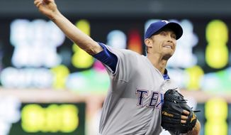 Texas Rangers pitcher Scott Baker throws against the Minnesota Twins in the first inning of a baseball game Tuesday, May 27, 2014, in Minneapolis. (AP Photo/Jim Mone)