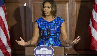First lady Michelle Obama speaks to school leaders and experts surrounding school nutrition, Tuesday, May 27, 2014, in the Eisenhower Executive Office Building on the White House complex in Washington. The meeting provided an opportunity for the Michelle Obama to hear directly from them about the work they are doing to improve school nutrition in their local districts. She stressed the importance of students, parents, school officials, community leaders, and health advocates coming together to protect and advance the tremendous progress that has been made in schools across our country. (AP Photo/Pablo Martinez Monsivais)