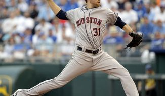 Houston Astros starting pitcher Collin McHugh throws during the first inning of a baseball game against the Kansas City Royals at Kauffman Stadium, Tuesday, May 27, 2014, in Kansas City, Mo. (AP Photo/Charlie Riedel)
