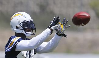 San Diego Chargers safety Alden Darby makes a catch during drills at an NFl football organized team activity Tuesday, May 27, 2014, in San Diego. (AP Photo/Lenny Ignelzi)