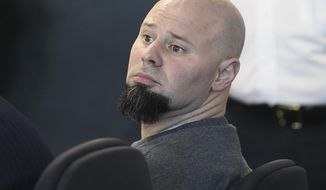 Jared Remy, son of Boston Red Sox baseball broadcaster Jerry Remy, sits in  Middlesex Superior Court during a hearing Tuesday, May 27, 2014, in Woburn, Mass. Remy, 35, pleaded guilty to first-degree murder and other charges for stabbing his girlfriend Jennifer Martel to death in August 2013, and was immediately given the mandatory sentence of life in prison without parole. (AP Photo/The Boston Globe, Joanne Rathe, Pool)