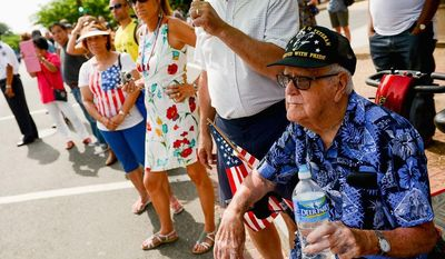 Retired Army Seaman Charles Wilson of Providence, R.I. (above), who landed in Guam during WWII, joins other visitors along Constitution Avenue to watch the National Memorial Day Parade on Monday.