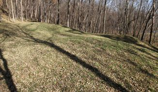 """FILE - In this Nov. 8, 2010 file photo are the """"Three Mounds"""" site at at Effigy Mounds National Monument in Harpers Ferry, Iowa. A retired park superintendent is facing a federal investigation three years after making a startling disclosure: He had a box of long-missing ancient Native American remains in his garage. (AP Photo/The Des Moines Register, Justin Hayworth, File) MAGS OUT; TV OUT; NO SALES; MANDATORY CREDIT"""
