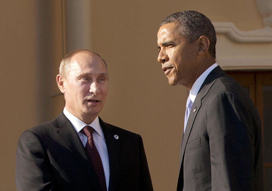 ** FILE **  President Obama shakes hands with Russian President Vladimir Putin during arrivals for the G-20 summit at the Konstantin Palace in St. Petersburg, Russia, Sept. 5, 2013.  (Associated Press)