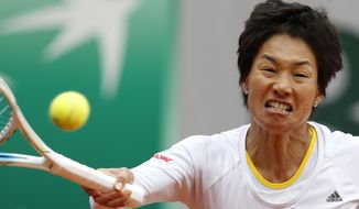 Japan's Kimiko Date-Krumm returns the ball to Russia's Anastasia Pavlyuchenkova during the first round match of  the French Open tennis tournament at the Roland Garros stadium, in Paris, France, Tuesday, May 27, 2014. (AP Photo/Darko Vojinovic)