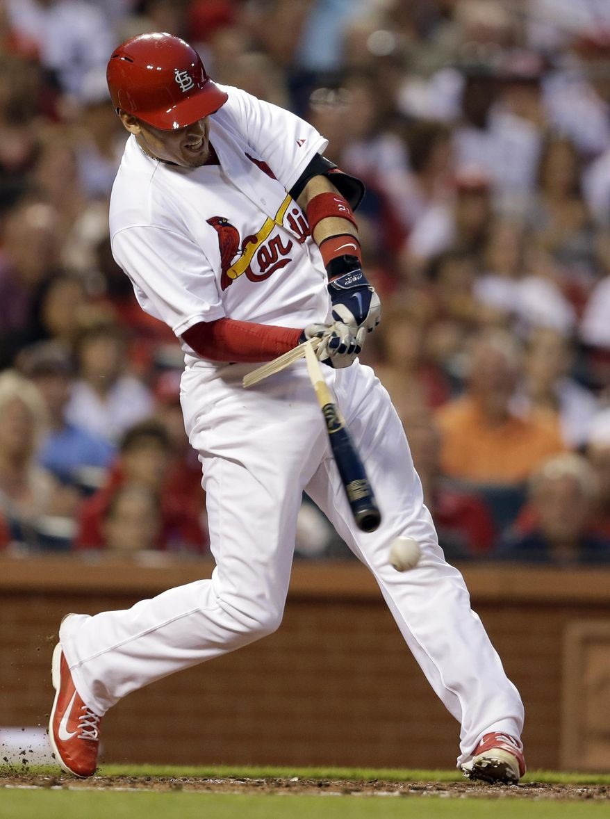 St. Louis Cardinals' Allen Craig breaks his bat during the third inning of a baseball game against the New York Yankees on Tuesday, May 27, 2014, in St. Louis. Craig reached on an error by Yankees first baseman Kelly Johnson, allowing Matt Holliday to score. (AP Photo/Jeff Roberson)