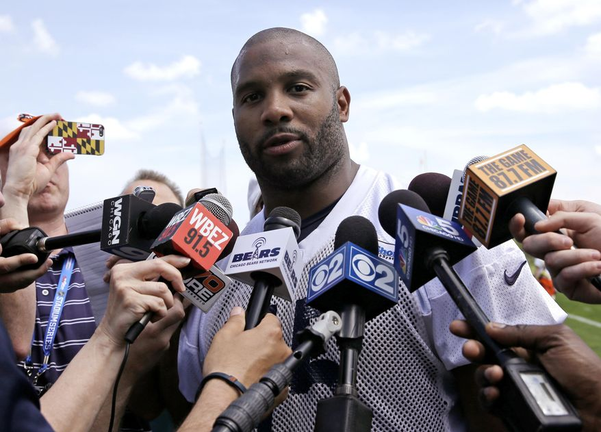 Chicago Bears linebacker Lance Briggs talks to reporters after NFL football practice in Lake Forest, Ill., Tuesday, May 27, 2014. (AP Photo/Nam Y. Huh)