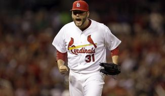 St. Louis Cardinals starting pitcher Lance Lynn celebrates after getting New York Yankees' Yangervis Solarte to ground into a double play, ending the top of the fourth inning of a baseball game Tuesday, May 27, 2014, in St. Louis. (AP Photo/Jeff Roberson)