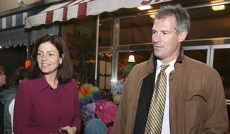 **FILE** In this Oct. 29, 2010 photo, then-New Hampshire Republican Senate candidate Kelly Ayotte (left) gets help from Sen. Scott Brown, R-Mass., in Concord, N.H. (Associated Press)