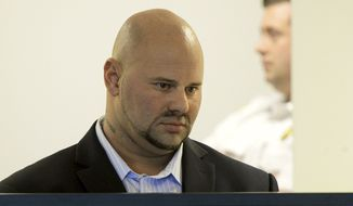 Jared Remy, son of Boston Red Sox broadcaster Jerry Remy, stands during arraignment Tuesday, Oct. 8, 2013, at Middlesex Superior Court in Woburn, Mass., on murder and assault charges in the death of his girlfriend Jennifer Martel. Remy pleaded not guilty in the stabbing of Martel at their Waltham apartment on Aug. 15.  (AP Photo/Boston Herald, Ted Fitzgerald, Pool)