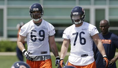 Chicago Bears defensive end Jared Allen (69), left, and defensive end Trevor Scott (76)watch teammates during an NFL football practice in Lake Forest, Ill., Tuesday, May 27, 2014. (AP Photo/Nam Y. Huh)