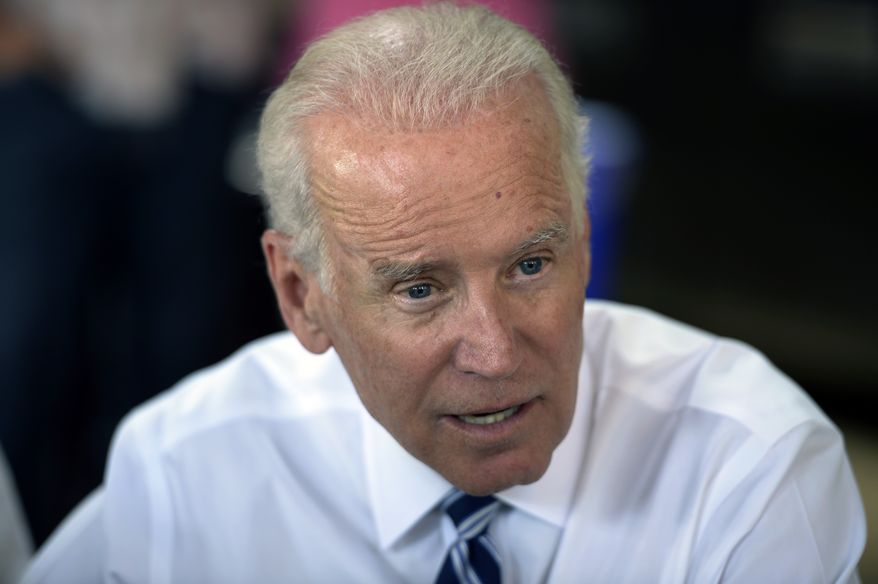 Vice President Joe Biden talk during a visit in Denver Tuesday, May 27, 2014. (AP Photo/The Denver Post, Karl Gehring) MAGS OUT; TV OUT; INTERNET OUT; NO SALES; NEW YORK POST OUT; NEW YORK DAILY NEWS OUT.