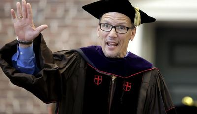 United States Labor Secretary Thomas Perez waves after being awarded with an honorary degree during commencement services on the campus of Brown University, Sunday, May 25, 2014, in Providence, R.I. (AP Photo/Steven Senne)