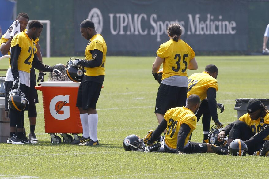 Members of the Pittsburgh Steelers secondary take a break during an NFL football organized team activity onTuesday, May 27, 2014 in Pittsburgh. (AP Photo/Keith Srakocic)