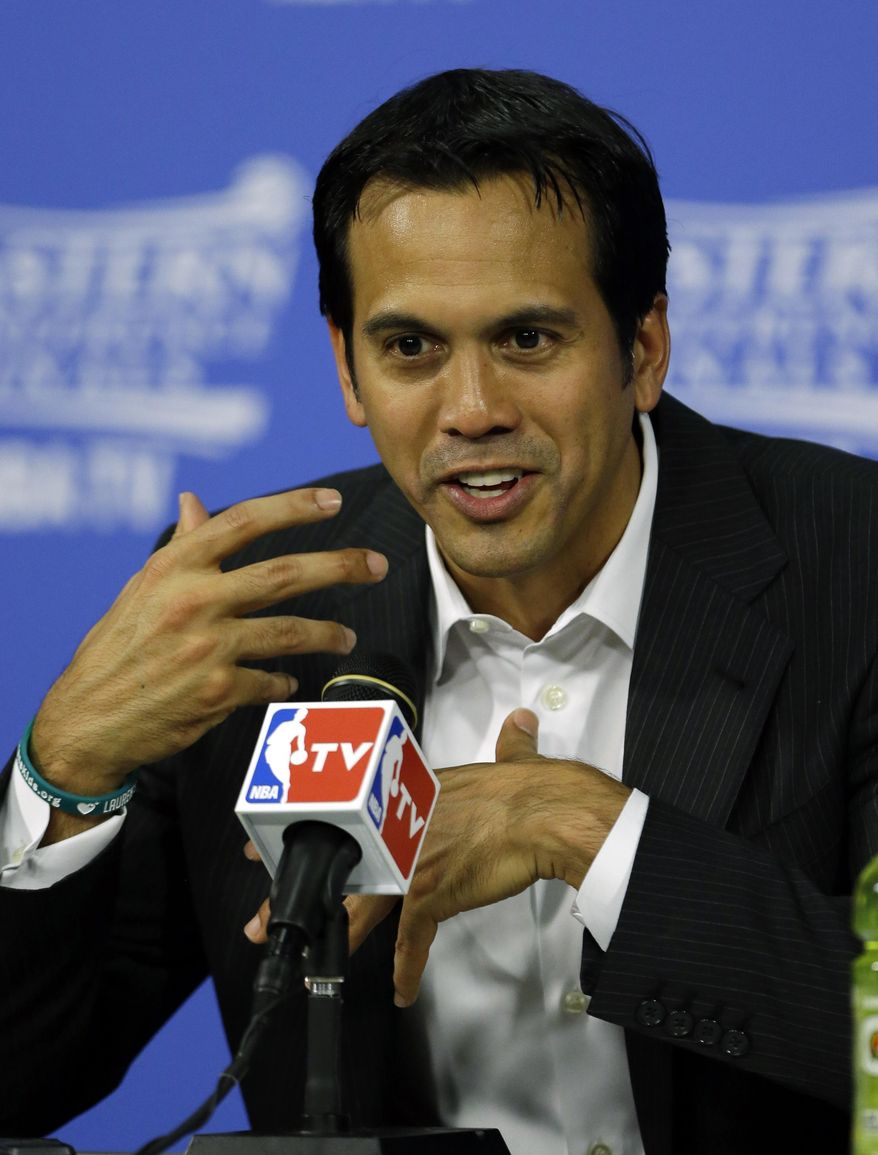 Miami Heat head coach Erik Spoelstra speaks during the post-game news conference after Game 4 in the NBA basketball Eastern Conference finals playoff series, Monday, May 26, 2014, in Miami. The Heat defeated the Pacers 102-90.(AP Photo/Wilfredo Lee)
