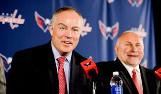 Washington Capitals owner Ted Leonsis and president Dick Patrick introduce new general manager Brian MacLellan, left, and head coach Barry Trotz, right, to the media at a press conference at the Verizon Center, Washington, D.C., Tuesday, May 27, 2014. (Andrew Harnik/The Washington Times)