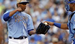 Kansas City Royals starting pitcher Yordano Ventura (30) takes the ball from catcher Salvador Perez, right, after loading the bases full during the first inning of a baseball game against the Houston Astros at Kauffman Stadium in Kansas City, Mo., Monday, May 26, 2014. (AP Photo/Orlin Wagner)