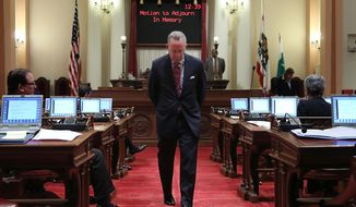 State Senate President Pro Tem Darrell Steinberg, D-Sacramento, paces the floor. as he wait to speak about the six young people who were killed last Friday, at the Capitol in Sacramento, Calif., Tuesday, May 27, 2014. Lawmakers say the state Legislature needs to do more to deter the type of violence carried out by 22-year-old Elliot Rodger, who killed six people and injured 13 others in the shooting and stabbing attacks Friday night, May 23, in the Isla Vista community near campus of the University of California, Santa Barbara. (AP Photo/Rich Pedroncelli)