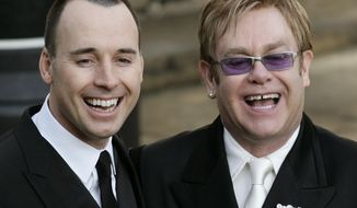 Elton John and partner David Furnish in 2005. (AP Photo/Lefteris Pitarakis, File)