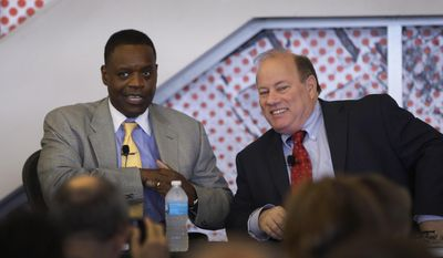 """State-appointed Emergency Manager Kevyn Orr, left, and Mayor Mike Duggan are seen during a news conference in Detroit, Tuesday, May 27, 2014. Removing blighted residential properties, lots and vacant commercial structures that have plagued Detroit neighborhoods for decades would cost $850 million, a task force said Tuesday. Blight has """"gone on for years"""" without a """"real strategy"""" and has gotten worse as a result, said Duggan. Orr called it an unprecedented effort. For the first time in Detroit's history, there is a """"comprehensive proposal to analyze all the properties in 144 square miles in the city,"""" Orr said. (AP Photo/Carlos Osorio)"""