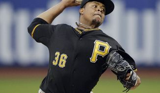 Pittsburgh Pirates' Edinson Volquez delivers a pitch during the first inning a baseball game against the New York Mets on Tuesday, May 27, 2014, in New York. (AP Photo/Frank Franklin II)