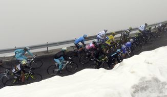 The pack pedals during the 16th stage of the Giro D'Italia cycling race from Ponte di Legno to Val Martello, Italy, Thuesday, May 27, 2014. (AP Photo/Fabio Ferrari)