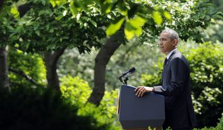 President Barack Obama speaks about the future of US troops in Afghanistan, Tuesday, May 27, 2014, in the Rose Garden of the White House in Washington. The president will seek to keep 9,800 US troops in Afghanistan after the war formally ends later this year and then will withdraw most of those forces by the end of 2016.  (AP Photo/Susan Walsh)